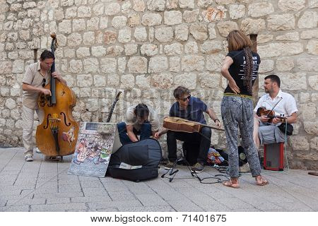 DUBROVNIK, CROATIA - MAY 26, 2014: Street band performing on Stradun.  Stradun is 300 meters long main pedestrian street in Dubrovnik.