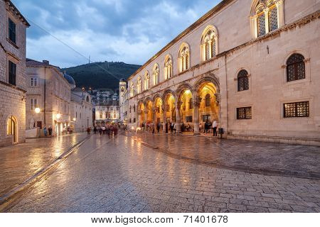 DUBROVNIK, CROATIA - MAY 27, 2014: Night shot of tourists in front of Rector's palace. Palace used to serve as seat of the Rector of the Republic of Ragusa and today is the museum.