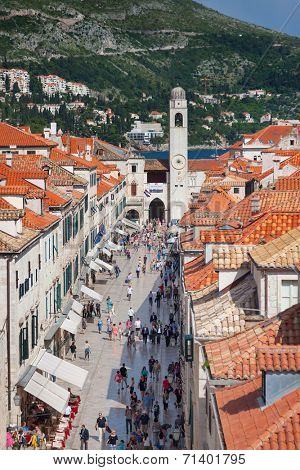 DUBROVNIK, CROATIA - MAY 26, 2014: View on Stradun and the Bell tower from old city walls. Stradun is 300 meters long main pedestrian street in Dubrovnik.