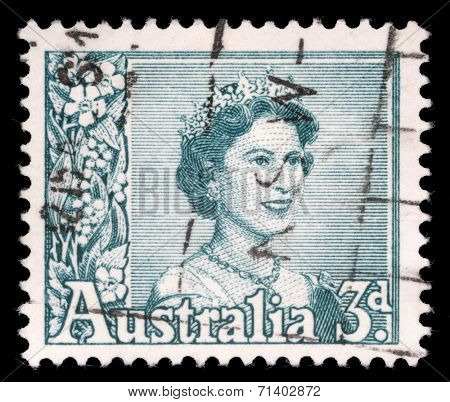 AUSTRALIA - CIRCA 1959: A stamp printed in Australia shows a portrait of Queen Elizabeth II, circa 1959.