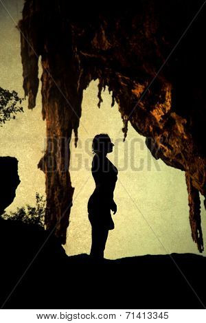 Woman silhouette in cave - Railay, Thailand
