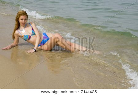 Beautiful Girl Lays In Surf