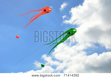 Orange and green space invader kites