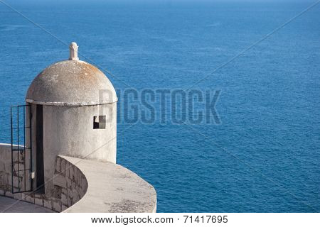 Gun turret on old city walls of Dubrovnik (Croatia) with Adriatic sea in background.