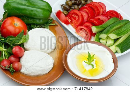 Lebanese food of Labneh Yogurt cheese and goat cheese with veggies