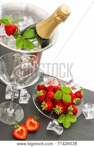 Champagne, Two Glasses And Strawberries