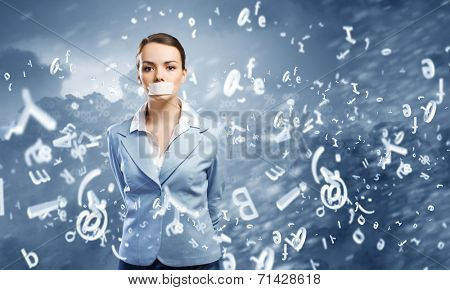 Young speechless businesswoman with adhesive tape on mouth