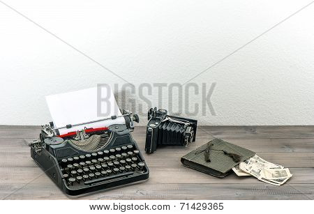 Retro Typewriter And Vintage Photo Camera. Antique Objects