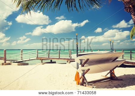 surfing, beach, summer and leisure concept - surfboards on tropical beach