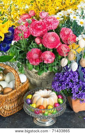 Spring Flowers With Easter Cake And Eggs Decoration