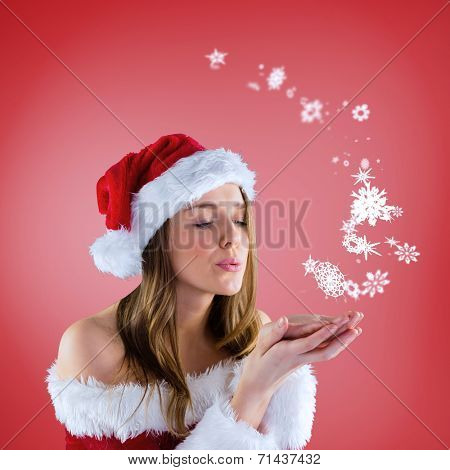 Composite image of sexy santa girl blowing over hands against red vignette