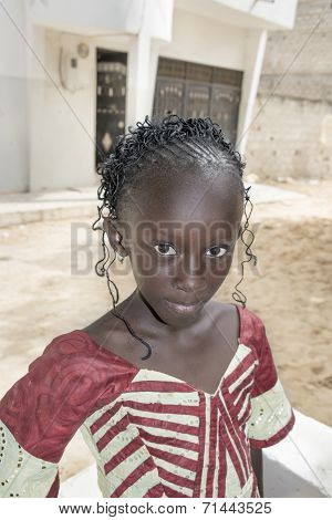 Unidentified child, traditional dress and hairstyle
