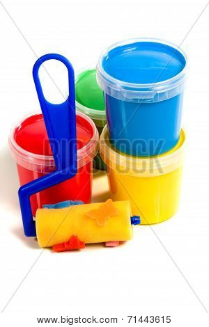 Children roller and jar with colorful paint