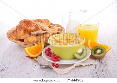 breakfast with cornflakes,croissant and fruits