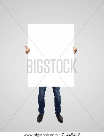 Man Holding Poster