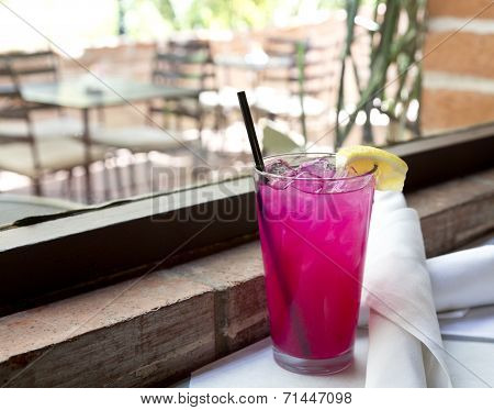 Icy Pink Lemonade In Tall Glass
