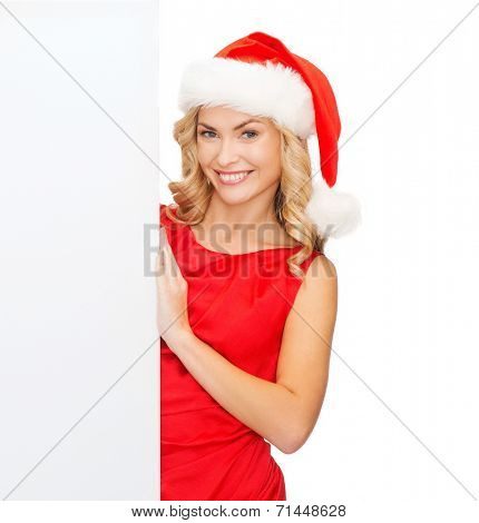 christmas, xmas, holidays and advertisement concept - happy asian woman in santa helper hat with blank white board