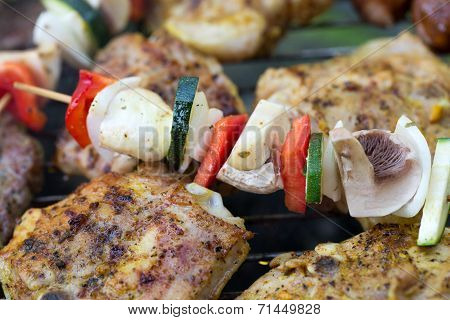 barbecue with delicious grilled meat and vegetables on grill