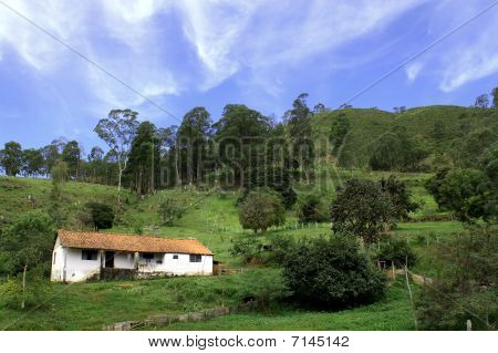 Small house in a small farm with mountains
