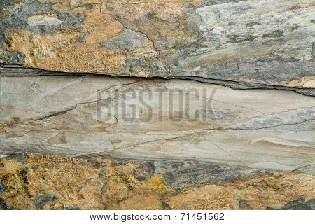 two layers of flat, multi color foliated slate rock