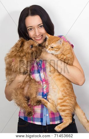 Nice Woman With The Cat And The Dog On His Hands