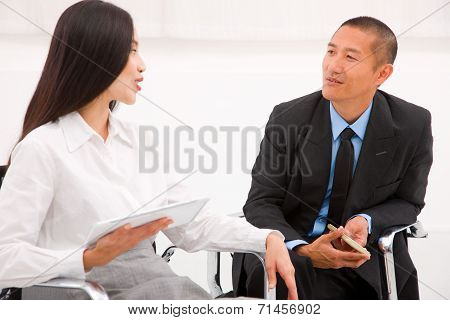 Two Businesspeople In Meeting