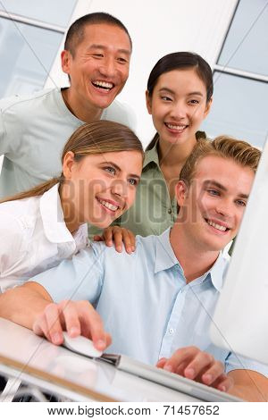 Diverse Group Of Happy People Looking Computer