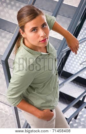 Close-up Of Young Woman Leaning Against Staircase