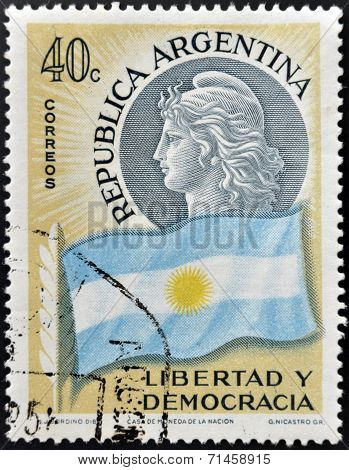 ARGENTINA - CIRCA 1958: A stamp printed in Argentina shows flag and woman freedom and democracy