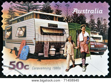 AUSTRALIA - CIRCA 2007: A stamp printed in australia shows Family enjoying a caravan of the 80s