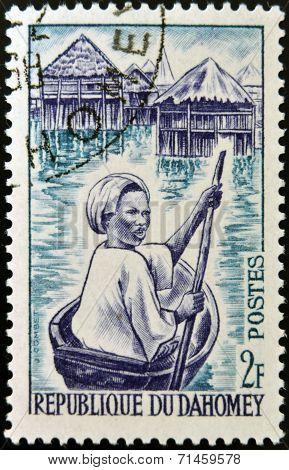 DAHOMEY - CIRCA 1963: stamp printed in Dahomey shows Ganvie Woman in Canoe circa 1963