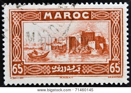 MOROCCO - CIRCA 1934: A stamp printed in Morocco shows capital city of Rabat on the Atlantic coast