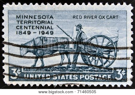 UNITED STATES OF AMERICA - CIRCA 1949: A stamp printed in USA shows the Pioneer and Red River Oxcart