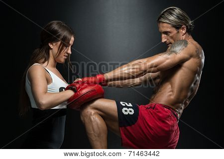 Woman Instructor And Man Training Mixed Martial Art