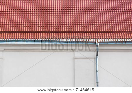 Rain Gutter And Red Tiled Roof