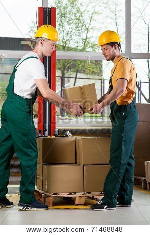 Two Men Working Together At Warehouse
