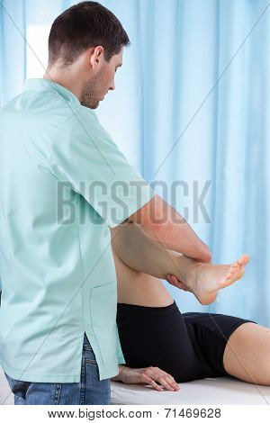 Physiotherapist Bending Knee