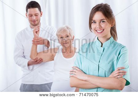 Elder Woman And Her Physiotherapist