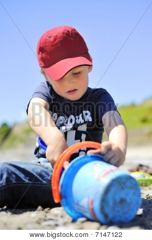 Boy playing the sand