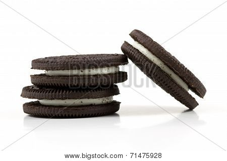 Chocolate Cookies With Cream Filling On White Background