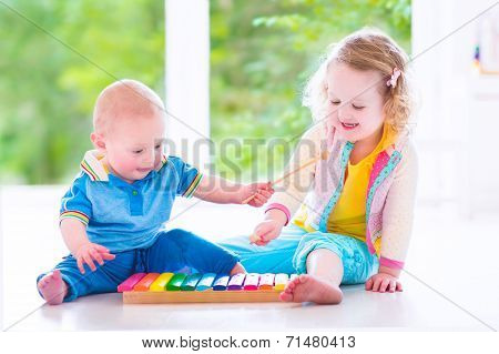 Kids Playing Music With Xylophone poster