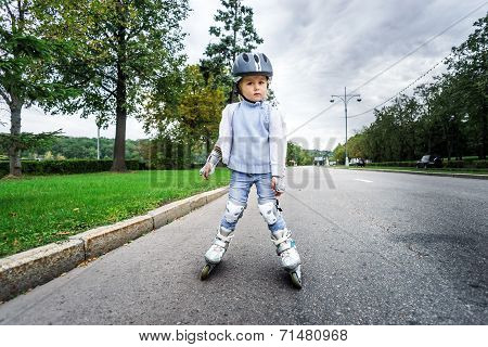Cute Little Girl Learning Rollerskating
