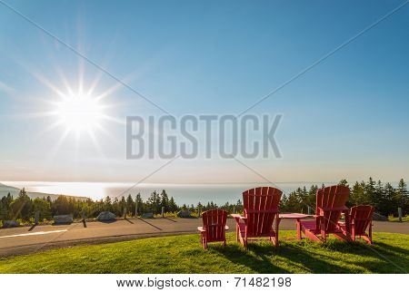 Red Chairs From Butland Lookoff  With A Beautiful View Of Fundy Shore Scenery