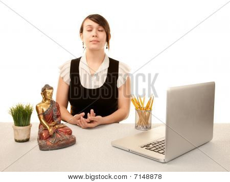 Woman Meditating At Her Desk