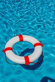 foto of crisis  - an emergency tire floating in a swimming pool - JPG