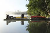 pic of loon  - Dock with Chairs Canoe and Kayak on a Misty Morning  - JPG