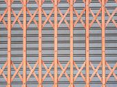 pic of roller shutter door  - orange Horizontal Shutter Door and gray vertical shutter door - JPG