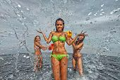 picture of nasty  - Sexy young girls on the beach have fun and laughing - JPG