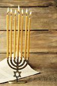 stock photo of menorah  - Menorah on wooden background - JPG