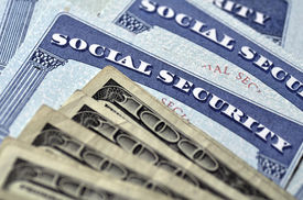 stock photo of social system  - Detail of several Social Security Cards and cash money symbolizing retirement pensions financial safety - JPG
